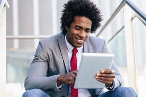 Black Businessman using a digital tablet photo