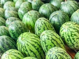 A Lot of big sweet green organic ripe watermelons In Supermarket photo