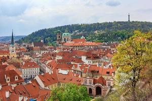 Old Town pier architecture and traditional red roofs in Prague photo