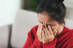 Mature senior woman suffering from headaches, Alzheimer Concept. photo