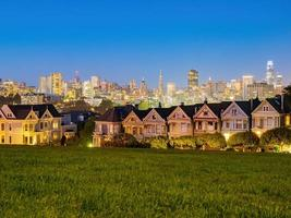 The famous Painted Ladies with the skyline of San Francisco, California, USA photo