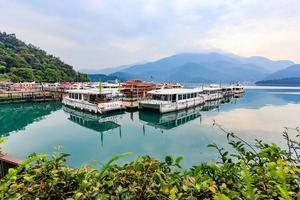 Nantou, Taiwan, Apr 02, 2017 - Boats in the harbor in the morning photo