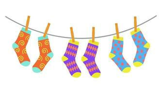 Three pairs of colorful children socks drying on the clothesline vector