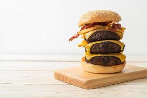 Hamburger or beef burgers with cheese, bacon and french fries photo