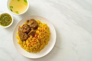 Beef biryani or curried rice and beef photo