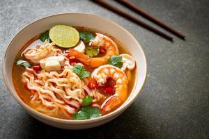 Instant noodles ramen in spicy soup with shrimps photo