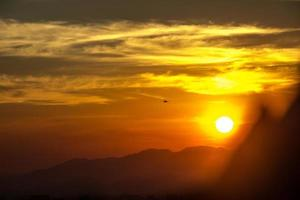 Silhouette of a plane with a beautiful sunset photo