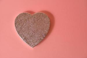 A big heart on a melon-colored background photo