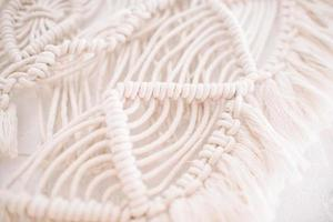 Handmade macrame pattern a fragment of a wall panel in the boho style photo