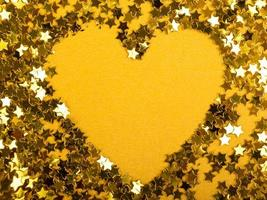 Valentine's day heart of gold stars on a yellow background photo
