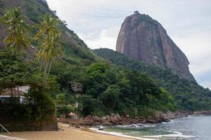 Red beach and Sugarloaf Hill in Rio de Janeiro, Brazil photo