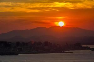 Sunset in Niteroi seen from the top of city park in Rio de Janeiro, Brazil photo