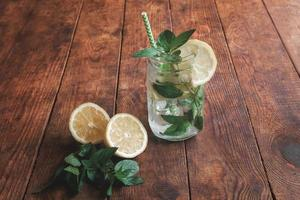 Summer citrus cocktail with lemon and mint, mohito photo