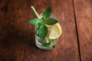 Mojito summer citrus cocktail with lemon and mint photo