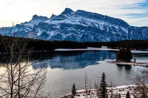 Rundle Mountain as seen from Two Jack Lake. Banff National Park. Alberta, Canada photo