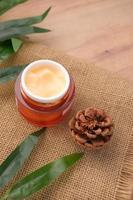 herbal cream cosmetic in a container on table, photo