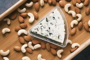 close up of fresh cheese , cashed and almond nut on table photo