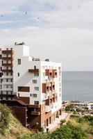 Modern hotel or apartment building on the seaside photo