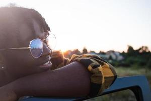 happy african american woman in a car, lifestyle photo