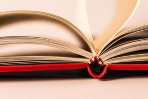 Close up open books on white background photo
