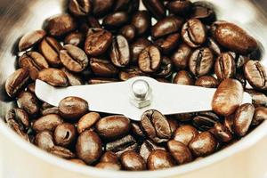 Close up coffee bean on coffee grinder photo