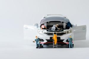 Miniature fixing car. business car service repair and maintenance photo