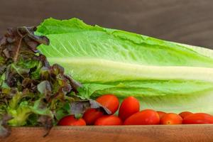 Close up red oak, romaine and cherry tomatoes photo