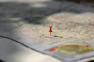Putting pins to destination on map photo