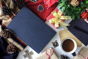 cup of coffee and Christmas decorations on table photo