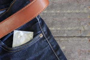 condom in jeans back pocket photo