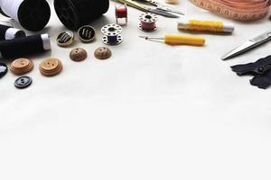 sewing tools on white fabric background photo