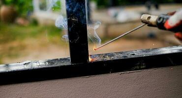 Welder Technician are welding steel with sparks photo