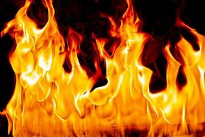 Fire flames on Abstract art black background photo