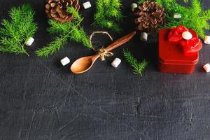 Wooden spoon and pine tree background Christmas background concept photo