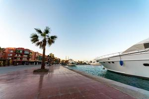 embankment street of the Red Sea in Egypt with ships boats photo