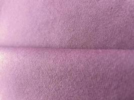 Purple color canvas texture folded fabric background photo