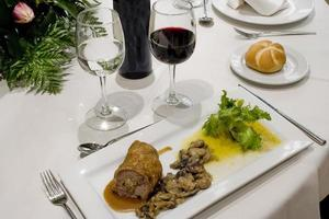 Plate of lamb meat on roll with mushrooms, sauce and salad, Spain photo