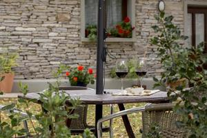 Two glasses of red wine in the courtyard of a house in Soria, Spain photo