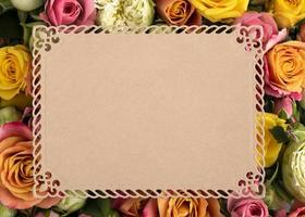 Top view beautiful flowers with blank frame photo