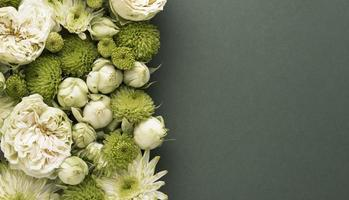 Flat lay beautifully bloomed flowers with copy space photo