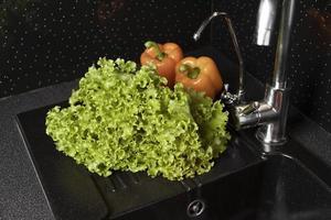 The arrangement of healthy food in fridge photo