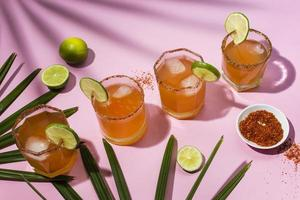 Spicy michelada drink assortment table photo
