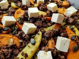 Casserole with pumpkin sheep cheese and potato wedges photo