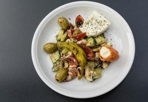 Greek salad with feta cheese olives and hot peppers photo