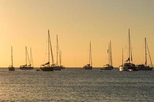 Yachts in Cala Saona Beach in Formentera in Spain in summer 2021 photo