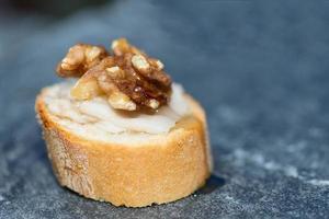 Slice of bread with walnut photo