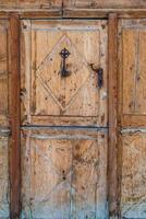 Ancient wooden door in a Swiss village photo