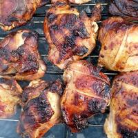grilled chicken meat on the grill ready for eating barbeque photo