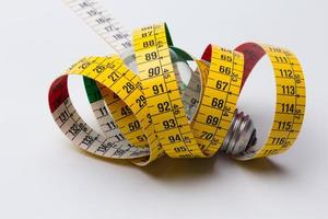 Yellow flexible tape measure photo