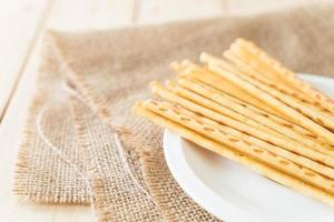 Biscuit stick on white plate photo